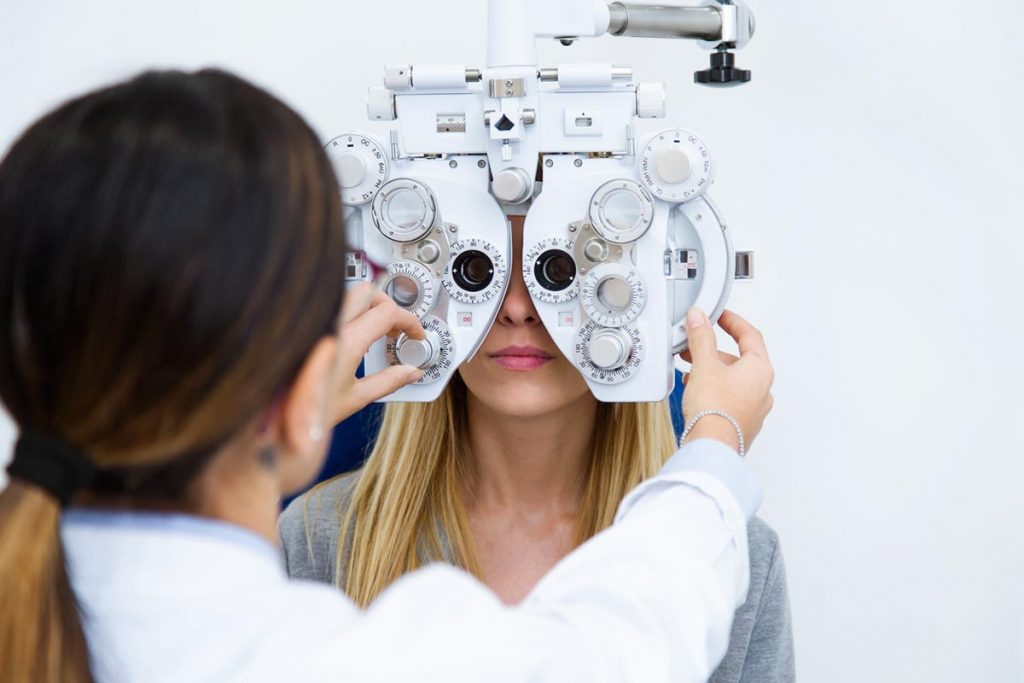 Optician examining a patient